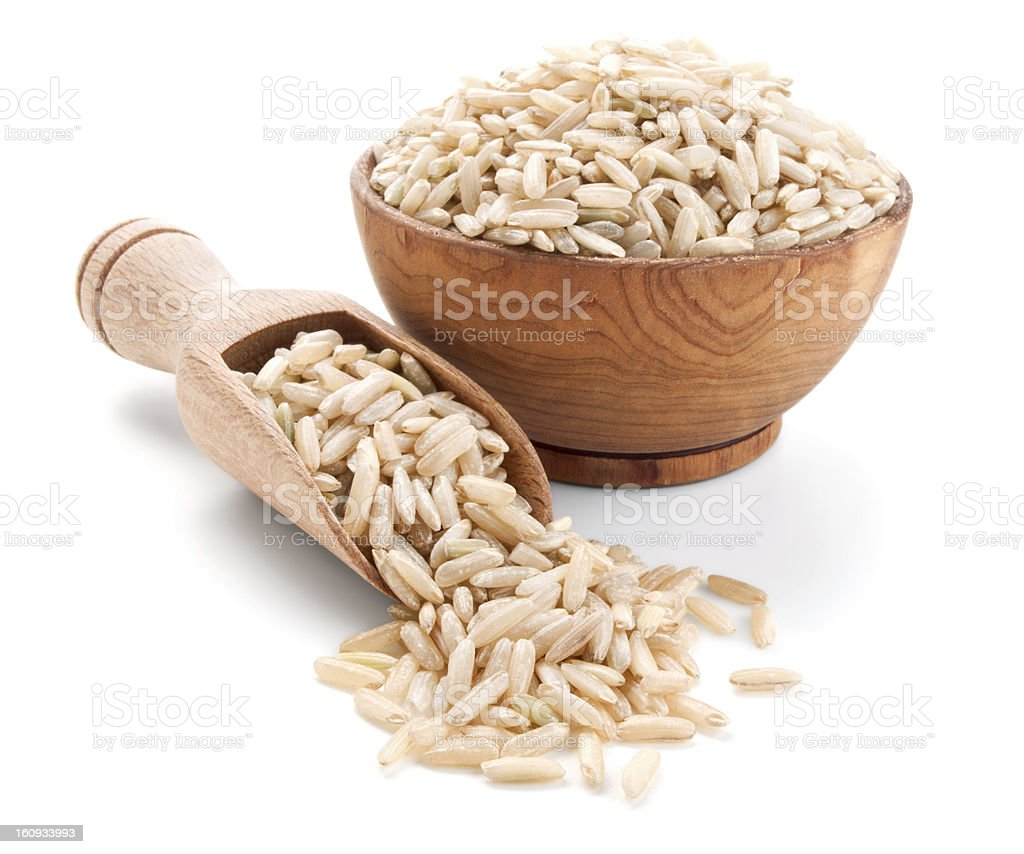 unpolished rice in a wooden bowl isolated on white royalty-free stock photo