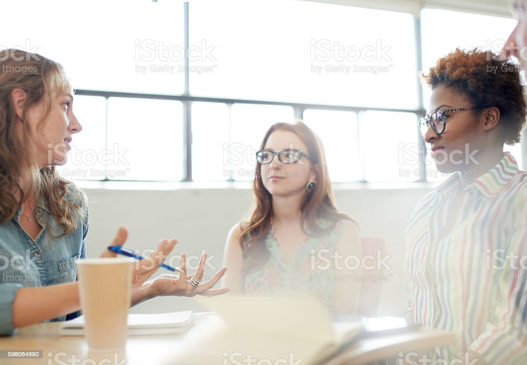 Unposed group of adult student in an open concept  class Candid picture of a university team working together.  Adult Stock Photo