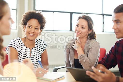istock Unposed group of creative business entrepreneurs in an open concept office brainstorming together on a digital tablet 643365488