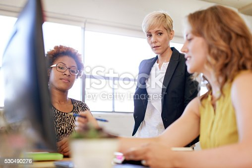 598064836 istock photo Unposed group of creative business people in an open concept 530490276