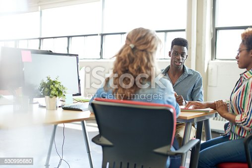 598064836 istock photo Unposed group of creative business people in an open concept 530995680