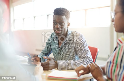 598064836 istock photo Unposed group of creative business people in an open concept 530995728