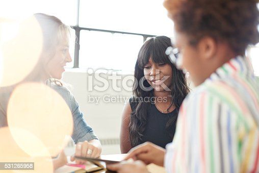 598064836 istock photo Unposed group of creative business people in an open concept 531265958