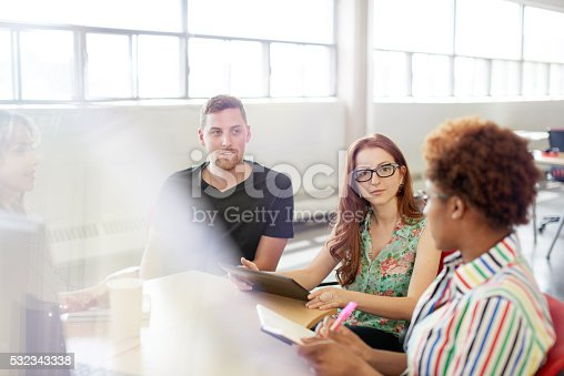 598064836 istock photo Unposed group of creative business people in an open concept 532343338