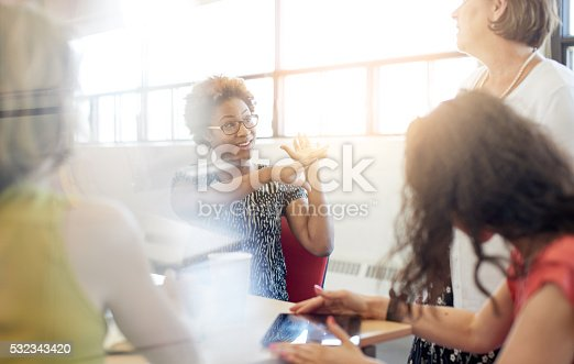 istock Unposed group of creative business people in an open concept 532343420