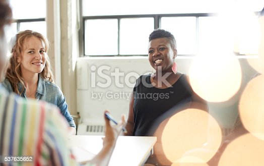 598064836 istock photo Unposed group of creative business people in an open concept 537635652