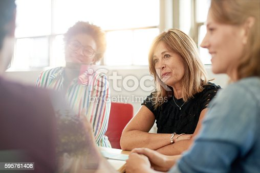 istock Unposed group of creative business people in an open concept 595761408