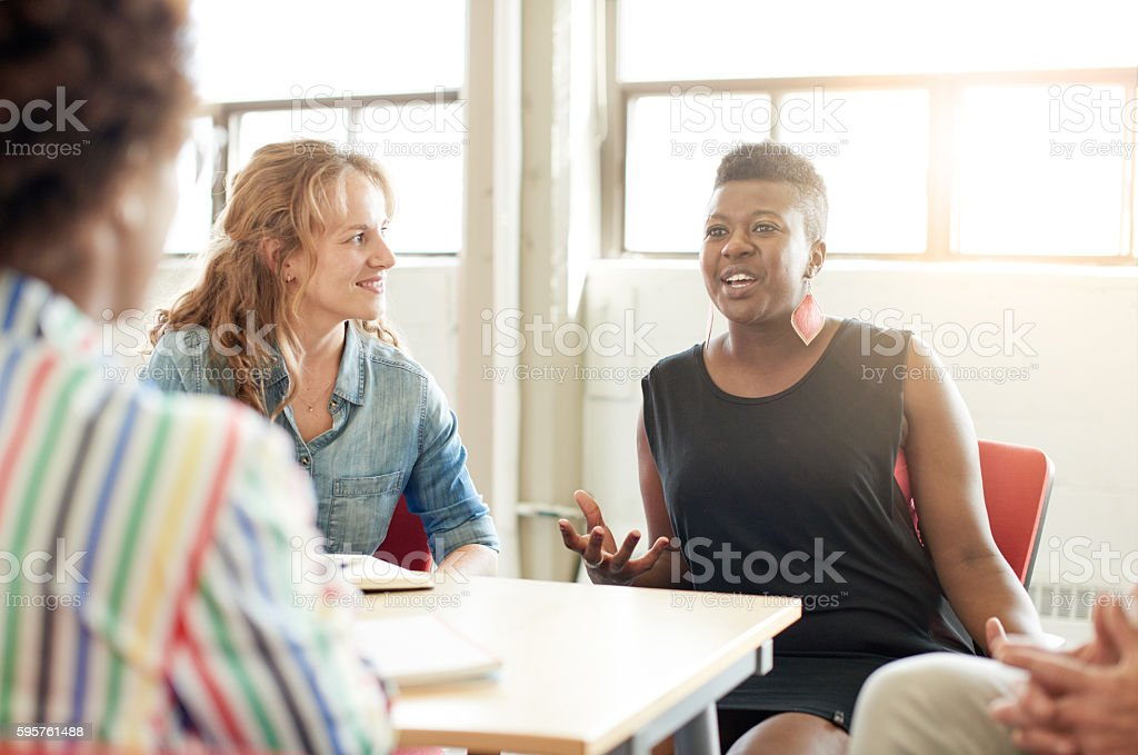 Unposed group of creative business people in an open concept royalty-free stock photo