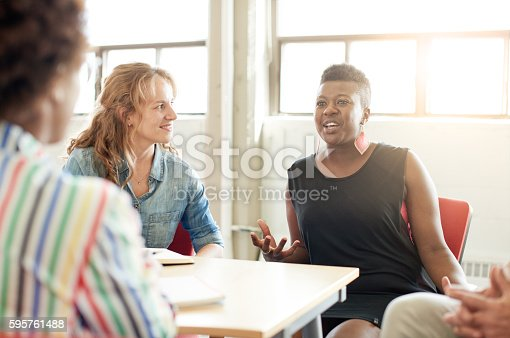 598064836 istock photo Unposed group of creative business people in an open concept 595761488