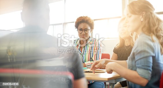 istock Unposed group of creative business people in an open concept 598064836