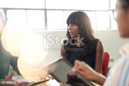 istock Unposed group of creative business people in an open concept 611899142