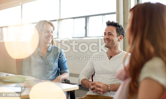 598064836 istock photo Unposed group of creative business people in an open concept 611899280