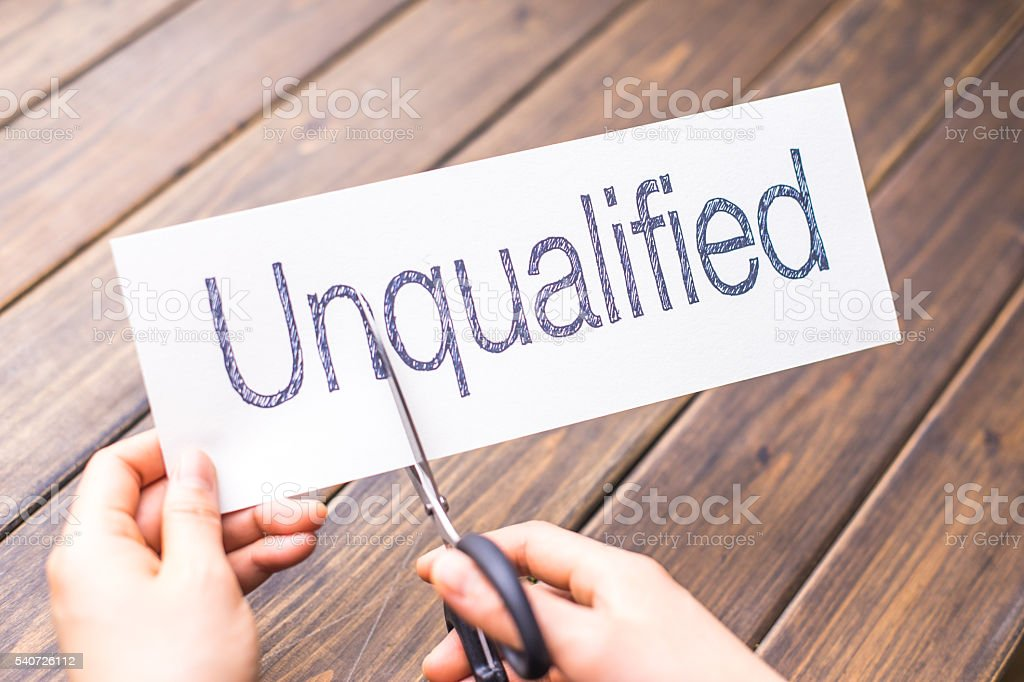 unqualified to qualified on paper by scissors stock photo