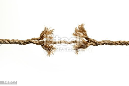 A frayed rope unraveling against a white background.