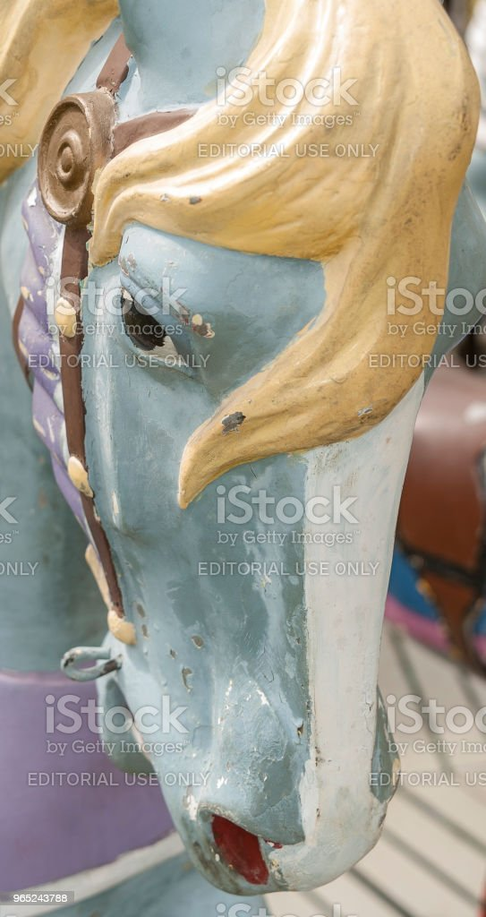 Unreadable look on weathered carousel horse royalty-free stock photo