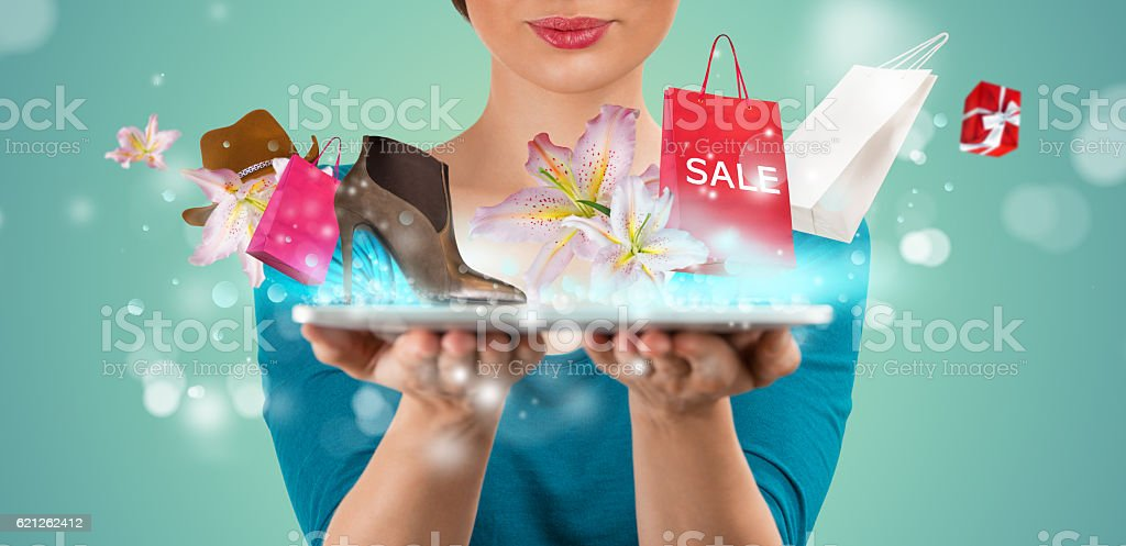 Unrecognisable woman shopping online using her tablet computer stock photo