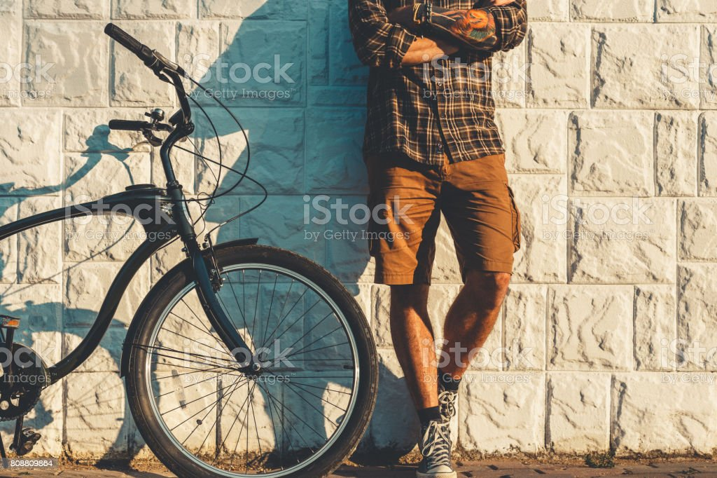 Unrecognizable Adult Man Standing With Bicycle Near Wall Daily Routine Lifestyle stock photo