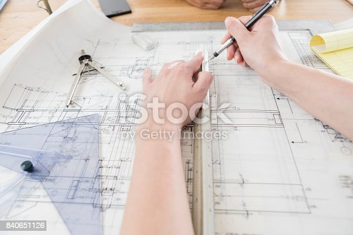 istock Unrecognizable architects work on technical drawing 840651126