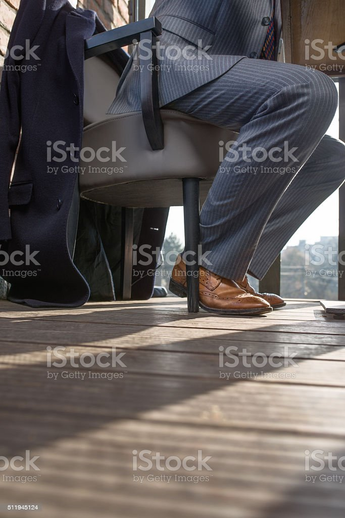 Unrecognizable business man sitting at the table stock photo