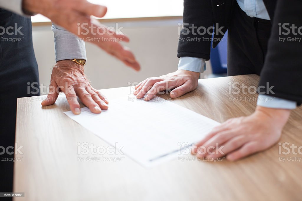 Unrecognizable business people discussing document stock photo