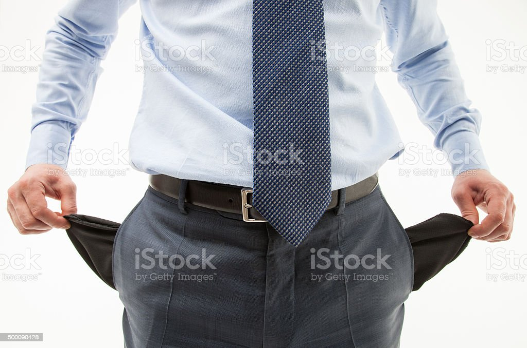 Unrecognizable businessman  demonstrating his empty pockets stock photo