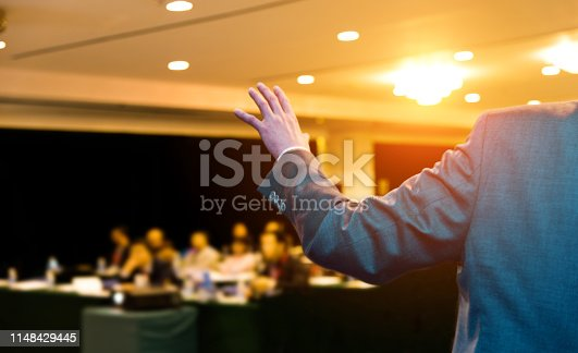 652281870 istock photo Unrecognizable businessman making a speech in front of audience at conference hall 1148429445