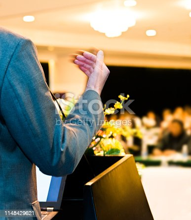 652281870 istock photo Unrecognizable businessman making a speech in front of audience at conference hall 1148429621