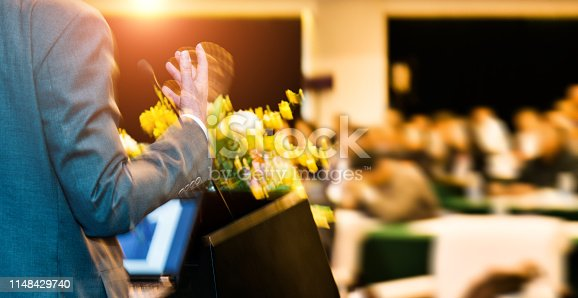 652281870 istock photo Unrecognizable businessman making a speech in front of audience at conference hall 1148429740