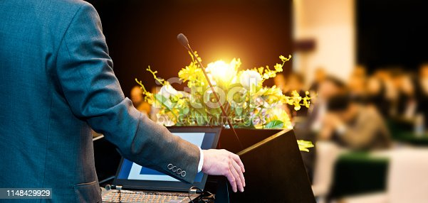 652281870 istock photo Unrecognizable businessman making a speech in front of audience at conference hall 1148429929