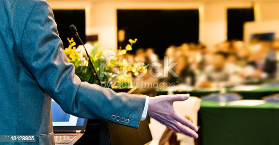 652281870 istock photo Unrecognizable businessman making a speech in front of audience at conference hall 1148429985