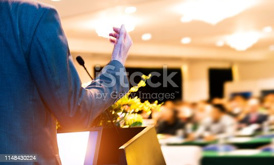 652281870 istock photo Unrecognizable businessman making a speech in front of audience at conference hall 1148430224
