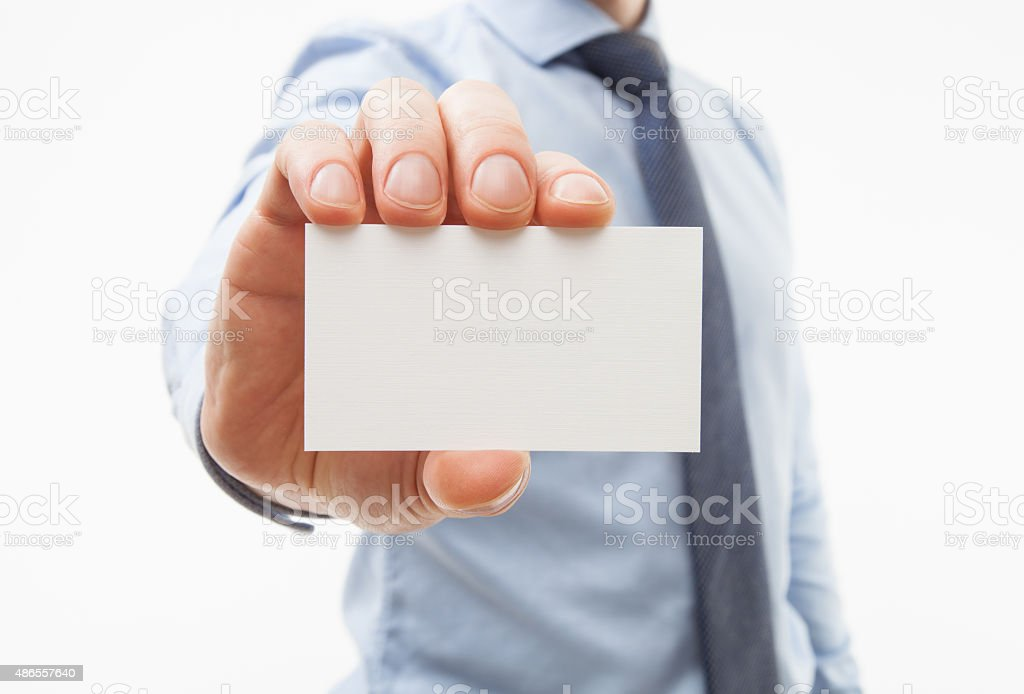 Unrecognizable businessman showing business card stock photo