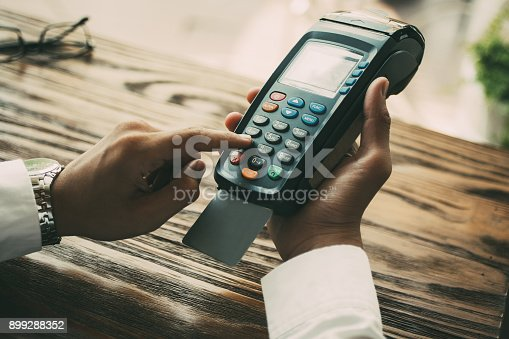istock Unrecognizable businessman spending money in cafe 899288352