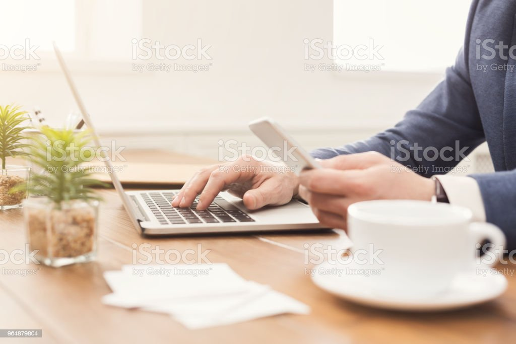 Unrecognizable businessman typing on laptop royalty-free stock photo