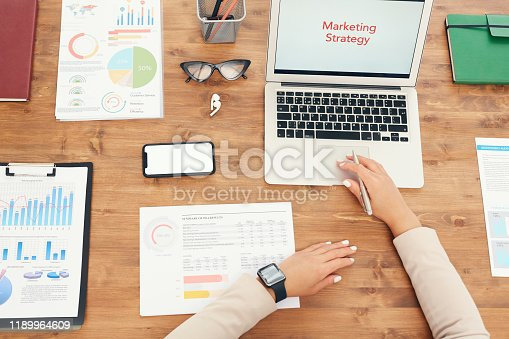 1133586715istockphoto Unrecognizable Businesswoman at Workplace Above View 1189964609