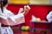 Unrecognizable couple during Karate training event