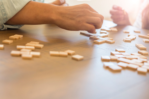 istock Unrecognizable couple organize word game tiles together 1069669072
