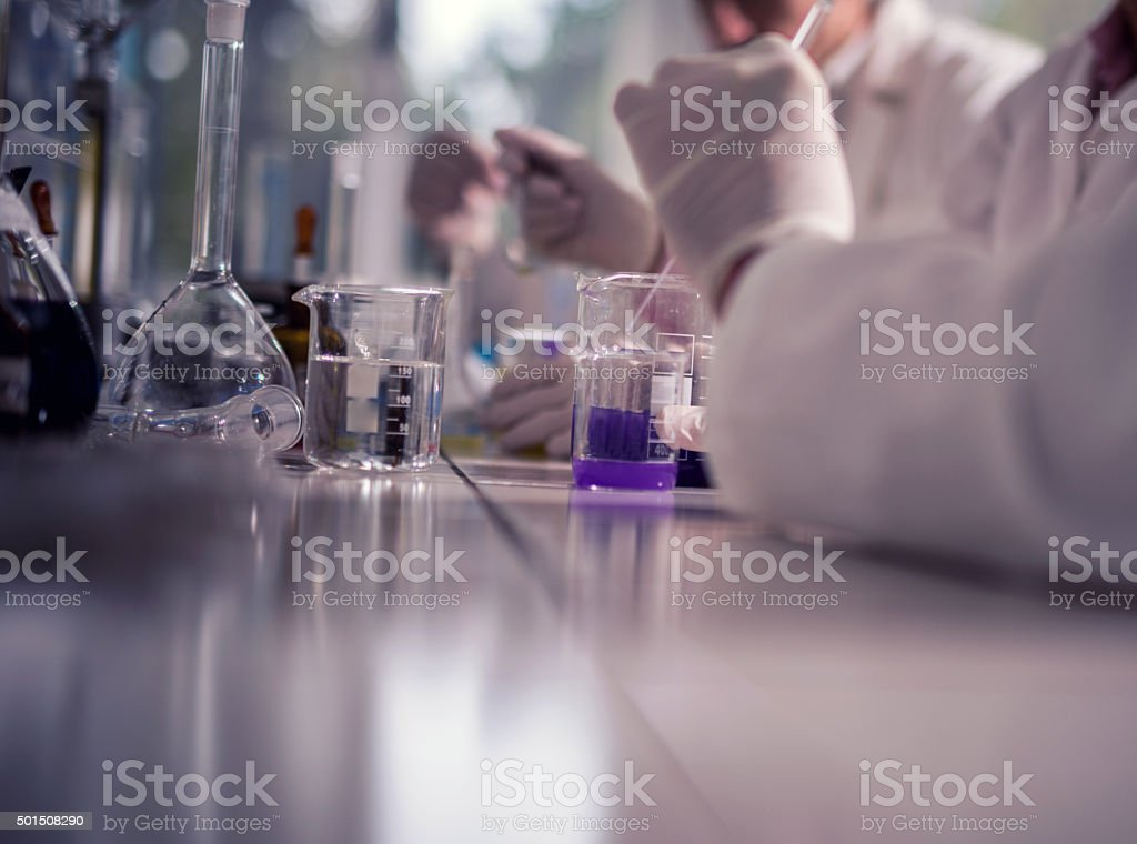 Unrecognizable doctor working with chemicals in a laboratory. stock photo