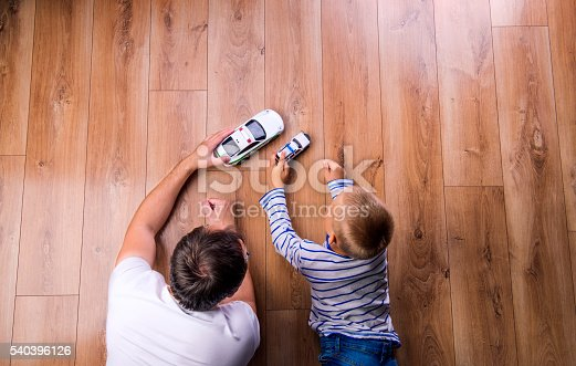 istock Unrecognizable father with his son playing with cars 540396126