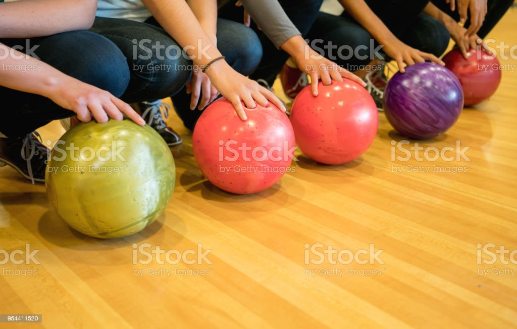 Unrecognizable female bowling players holding the bowling balls stock photo