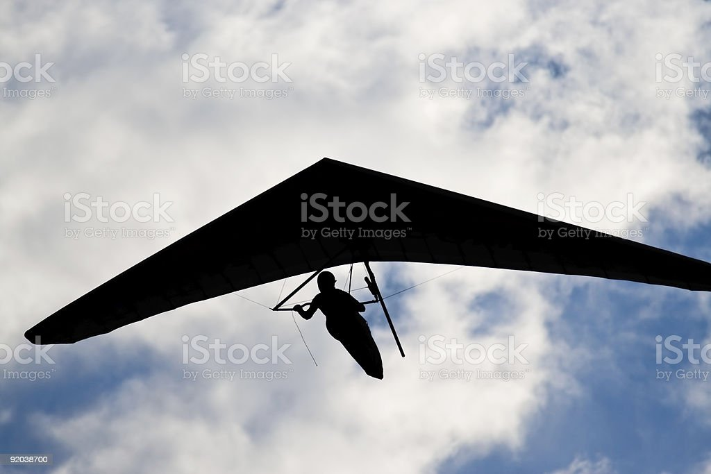 Unrecognizable hangglider pilot in the blue cky royalty-free stock photo
