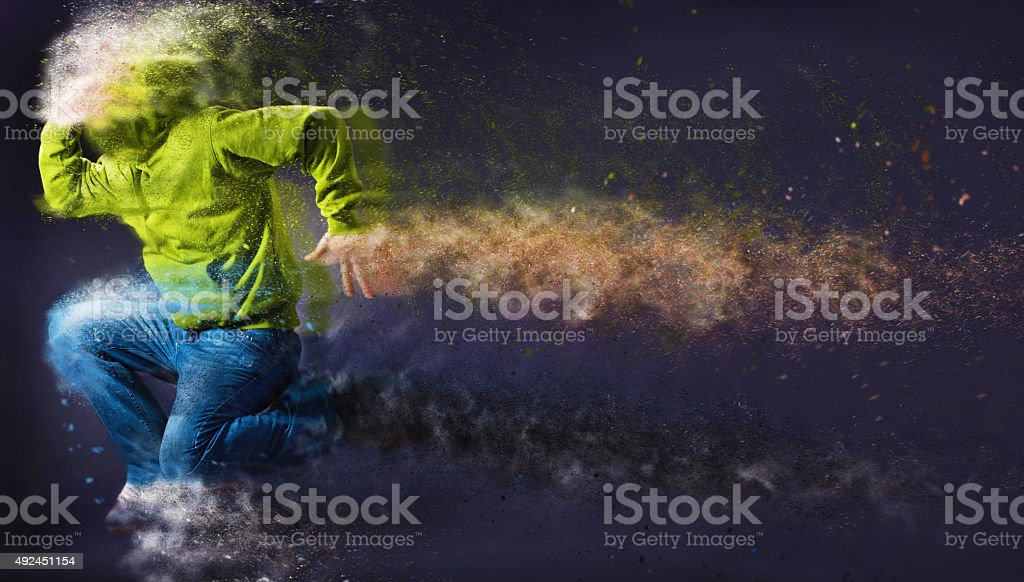 Unrecognizable Hip-hop male dancer with hoodie jumping stock photo