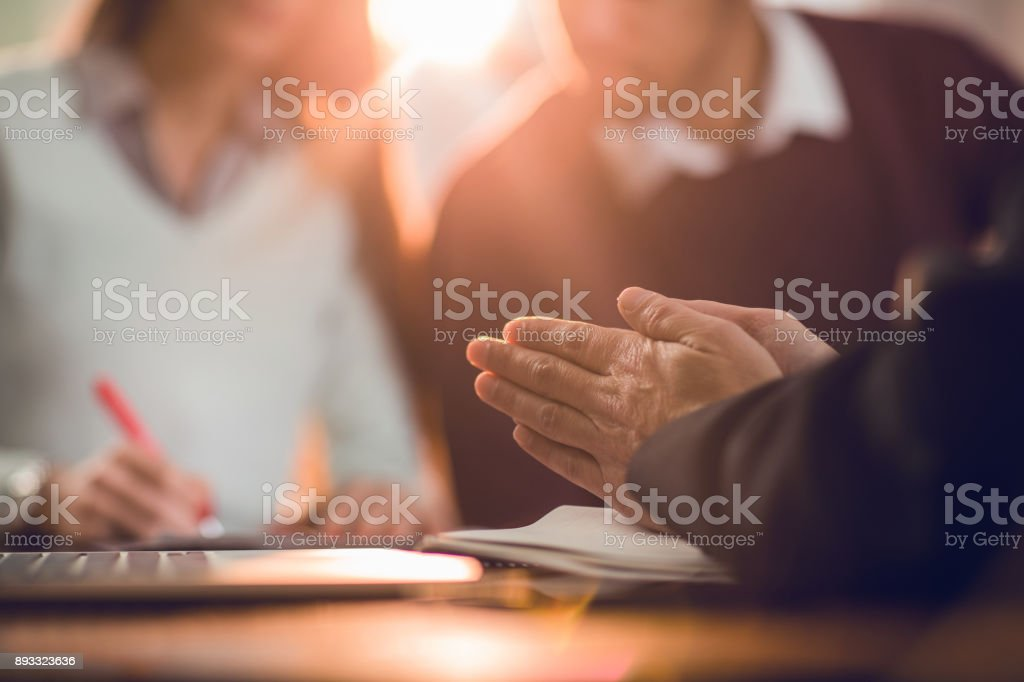 Unrecognizable insurance agent rubbing his hands while making a fraud. – zdjęcie