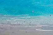 unrecognizable kitesurfer from high drone angle