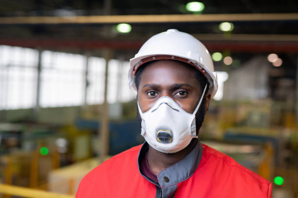 Unrecognizable Male Engineer In Mask stock photo