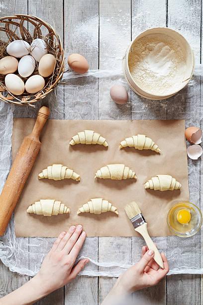 Unrecognizable man hands prepare dough for croissant sweet dessert stock photo