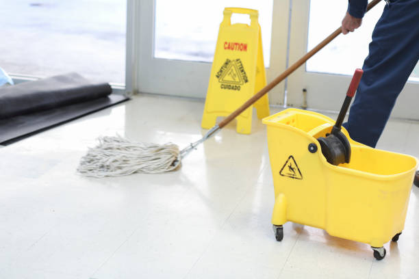 unrecognizable man mopping floor in office building. - custodian stock pictures, royalty-free photos & images