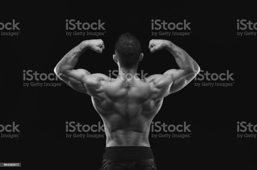 Unrecognizable man shows strong back muscles closeup - Royalty-free Adult Stock Photo