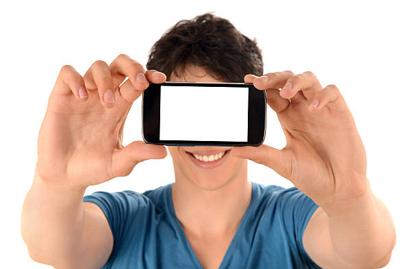 Unrecognizable man taking a selfie photo with his smart phone. stock photo