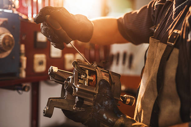 unrecognizable manual worker working on electric motor. - elektrische motor stockfoto's en -beelden